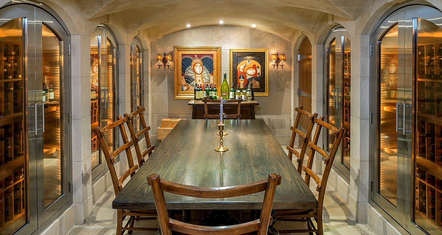 A subterranean wine cellar and tasting room with arched doorways inspired by catacombs